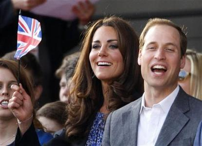 Britain's Catherine, Duchess of Cambridge waves a Union Flag as she watches with Prince William during the Diamond Jubilee concert in front of Buckingham Palace in London June 4, 2012. Pop royalty including Paul McCartney, Stevie Wonder and Elton John will entertain Queen Elizabeth on Monday on the third day of her Diamond Jubilee celebrations, with 10,000 ticket-holders who watching the performances live on a circular stage. REUTERS/Dave Thompson/pool
