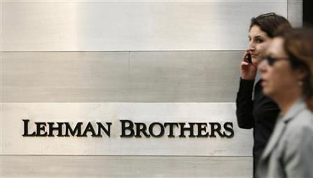 Pedestrians walk past a Lehman Brothers sign in New York, June 19, 2008. REUTERS/Lucas Jackson