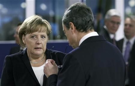 German Chancellor Angela Merkel (L) speaks with the President of the European Central Bank (ECB), Mario Draghi, before the start of a meeting on the second day of the G20 Summit in Cannes, France November 4, 2011. REUTERS/Chris Ratcliffe/pool