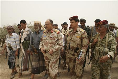 Yemen's Defence Minister, Major General Muhammad Nasir Ahmad, (C) visits the front line during fights between army forces and al Qaeda-linked militants in the southern province of Abyan June 4, 2012. REUTERS/Yemen's Defence Ministry/Handout