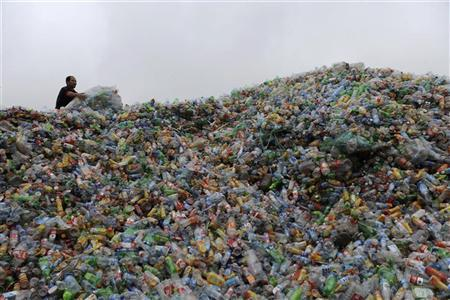 A labourer collects plastic bottles at a recycling centre in Jiaxing, Zhejiang province November 6, 2011. REUTERS/Stringer