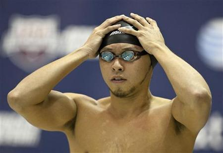 Kosuke Kitajima of Japan prepares to swim in the men's 100 meter breaststroke during the AT&T Winter National Championships in Atlanta, Georgia December 2, 2011. REUTERS/Chris Keane