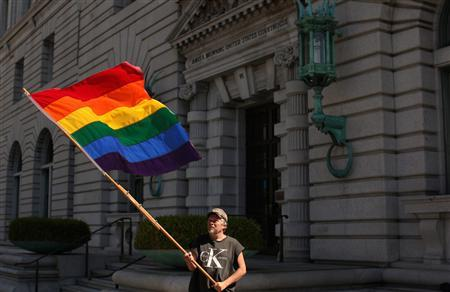 Bob Sodervick waves a rainbow flag outside the U.S. Courthouse in San Francisco, California June 5, 2012. The 9th U.S. Circuit Court of Appeals cleared the way on Tuesday for the U.S. Supreme Court to consider California's gay marriage ban, declining an appeal to revisit the case. Supporters of the 2008 ban, Proposition 8, have lost two rounds in federal court but have made clear they will appeal to the U.S. Supreme Court and hope for a favorable response from the conservative-leaning court. REUTERS/Robert Galbraith
