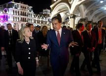 Georgian President Mikheil Saakashvili talks with U.S. Secretary of State Hillary Clinton (L) as they leave following a cultural dancing and singing performance at the Piazza in Batumi June 5, 2012. REUTERS/Saul Loeb/Pool