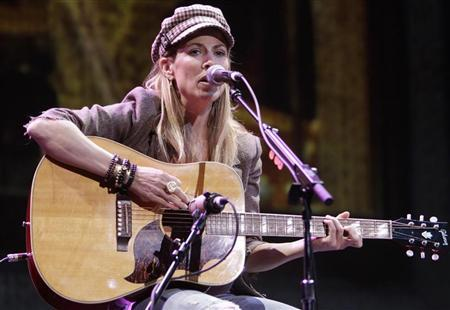 Singer/songwriter Sheryl Crow performs for Starbucks shareholders at the coffee company's annual meeting in Seattle, Washington March 24, 2010. REUTERS/Robert Sorbo
