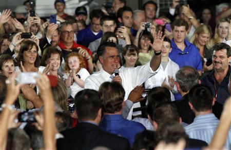 Republican presidential candidate Mitt Romney is welcomed by his supporters during a campaign stop at Southwest Office Systems in Fort Worth, Texas June 5, 2012. REUTERS/Darrell Byers