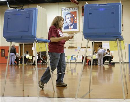 A voter prepares to cast her ballot at the Dr. Martin Luther King Jr. Community Center in Racine, Wisconsin June 5, 2012. REUTERS/John Gress