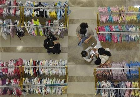 Customers browse clothes at a department store in Nanjing, Jiangsu province June 2, 2012. REUTERS/Sean Yong