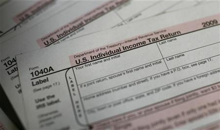 U.S. 1040A Individual Income Tax forms are seen at a U.S. Post office in New York April 15, 2010. April 15 is the deadline for filing taxes in the United States. REUTERS/Mike Segar