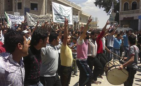 Demonstrators protest against Syria's President Bashar al-Assad in Binsh near Idlib June 1, 2012. REUTERS/Shaam News Network/Handout