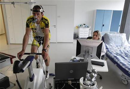 Doctor David Bailey cycles on an exercise bike during a performance assessment in the Nestle metabolic unit in Lausanne June 6, 2012. REUTERS/Ruben Sprich
