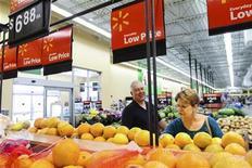 Wal-Mart shareholders Bob and Sharon Frye shop at a Wal-Mart Neighborhood Market store in Bentonville, Arkansas, May 31, 2012. REUTERS/Jacob Slaton