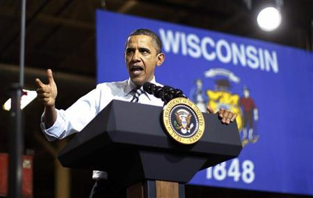 U.S. President Barack Obama delivers remarks on American manufacturing jobs during this visit to Master Lock in Milwaukee, Wisconsin February 15, 2012. REUTERS/Jason Reed