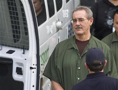 Allen Stanford leaves the Federal Courthouse where the jury found him guilty, in Houston March 6, 2012. Stanford was convicted on Tuesday of running a $7 billion Ponzi scheme, a verdict that caps a riches-to-rags trajectory for the former Texas financier and Caribbean playboy. He was found guilty on 13 counts of a 14-count criminal indictment, including fraud, conspiracy and obstructing an investigation by the U.S. Securities and Exchange Commission. REUTERS/Donna W. Carson