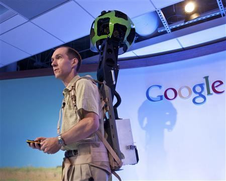 Luc Vincent, Google Engineering Director, demonstrates how Google captures images in hard to reach places with Street View Trekker at the Google offices in San Francisco, California, June 6, 2012. REUTERS/Google/Handout