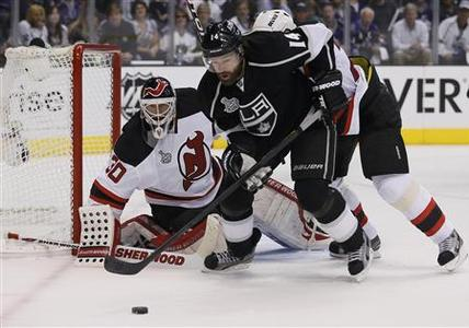 Los Angeles Kings Justin Williams (R) moves in on a rebound from New Jersey Devils goalie Martin Brodeur (L) during the first period in Game 4 of the NHL Stanley Cup hockey final in Los Angeles, June 6, 2012. REUTERS/Lucy Nicholson