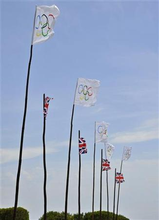 Olympic and Union flags are seen flying outside a hotel in Sennen near Lands End in Cornwall, southwest England May 17, 2012. REUTERS/Toby Melville