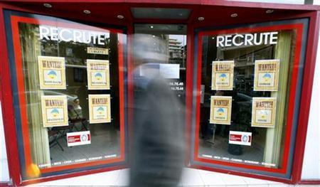 A man walks past a temping agency in Nice February 26, 2009. REUTERS/Eric Gaillard