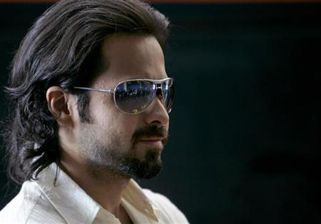 Bollywood film star Emraan Hashmi poses for photographers at Kings Cross station in central London June 6, 2007. REUTERS/Toby Melville/Files