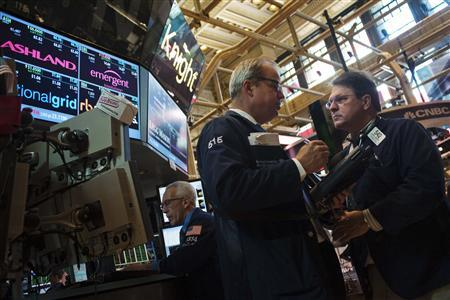 Traders work on the floor of the New York Stock Exchange in New York, June 7, 2012. REUTERS/Keith Bedford