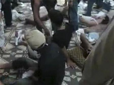 The bodies of people whom anti-government protesters say were killed by government security forces lie on the ground at Mazraat al-Qabeer near Hama in this still image taken from video June 6, 2012. REUTERS/Shaam News Network/Handout