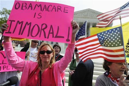 Opponents of Obama health care legislation rally on the sidewalk ...