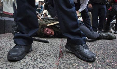 Occupy Wall Street movement activist Jeremy Deheart is arrested by police during a march through downtown Manhattan, New York in this May 1, 2012 file photograph. REUTERS/Adrees Latif/Files