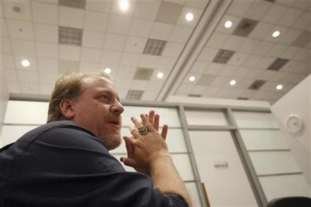 Former MLB player Curt Schilling talks with a reporter at the Electronic Entertainment Expo, or E3, in Los Angeles, California June 9, 2011. REUTERS/David McNew/Files