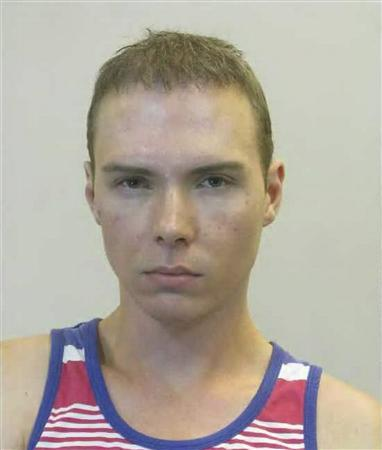 Luka Rocco Magnotta is shown after his arrest in this June 4, 2012 handout photo provided by the Berlin police. REUTERS/Berlin Police/Handout