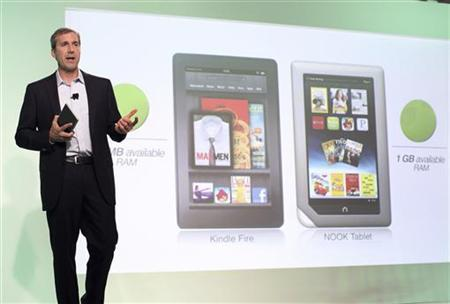 William Lynch, Chief Executive Officer of Barnes & Noble, holds the new Nook Tablet at the Union Square Barnes & Noble in New York, November 7, 2011. REUTERS/Shannon Stapleton