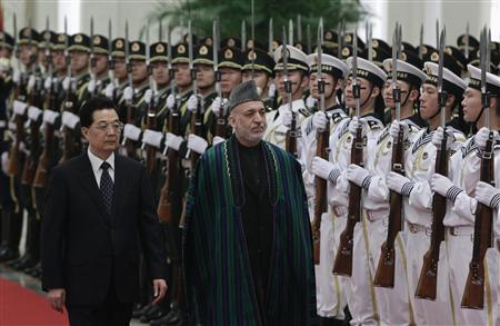 Chinese President Hu Jintao (L) and his Afghan counterpart Hamid Karzai review an honour guard during a welcoming ceremony for the Shanghai Cooperation Organization (SCO) summit at the Great Hall of the People in Beijing June 8, 2012. REUTERS/Jason Lee