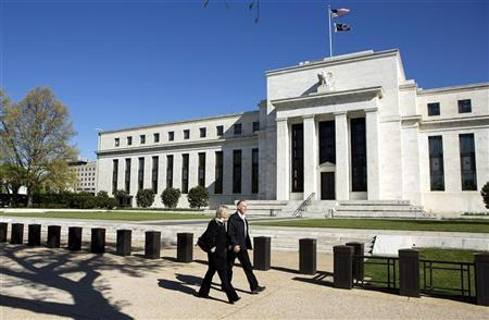 Pedestrians walk past the Federal Reserve Building in Washington April 3, 2012. REUTERS/Joshua Roberts