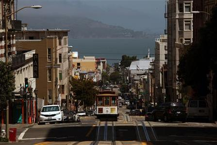 A cable car climbs Powell Street as it approaches California Street in San Francisco, California May 27, 2012. With its striking cityscapes and an eclectic offering of food, arts and culture, San Francisco captivates travelers and residents alike. Picture taken May 27, 2012.REUTERS/Robert Galbraith