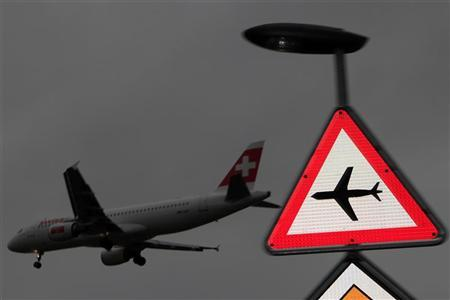 A Swiss airline plane prepares to land at Cointrin airport in Geneva March 20, 2012. REUTERS/Denis Balibouse