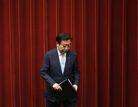 Japan's Prime Minister Yoshihiko Noda leaves after a news conference in Tokyo June 8, 2012. REUTERS/Kim Kyung-Hoon