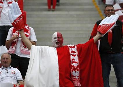 A fan of Poland cheers before the start of their Group A Euro 2012 soccer match against Greece at the National stadium in Warsaw June 8, 2012. REUTERS/Pascal Lauener
