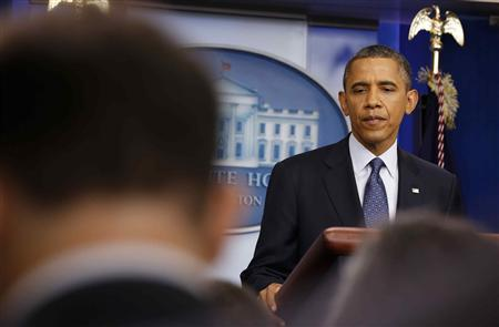 U.S. President Barack Obama pauses while speaking about the economy in the White House Press Briefing Room in Washington, June 8, 2012. REUTERS/Larry Downing