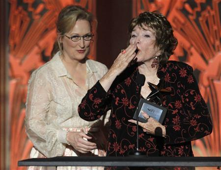 Actress Shirley MacLaine (R) blows a kiss to the audience at the end of her speech at the TV Land cable channel taping of the AFI Life Achievement Award, honoring MacLaine, in Los Angeles June 7, 2012. Actress Meryl Streep (L), recipient of the award in 2004, presented the award to MacLaine. The show will be telecast June 24. REUTERS/Fred Prouser