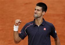 Novak Djokovic of Serbia reacts during his men's singles semi-final match against Roger Federer of Switzerland at the French Open tennis tournament at the Roland Garros stadium in Paris June 8, 2012. REUTERS/Benoit Tessier