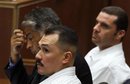 Defendant Marvin Norwood (R) his attorney Victor Escobedo and co-defendant Louie Sanchez (foreground) sit in court during their preliminary hearing in the Bryan Stow beating case in Los Angeles June 8, 2012. A judge ordered on Friday that Norwood and Sanchez to stand trial on charges that they assaulted San Francisco Giants fan Stow at Dodger Stadium in 2011. REUTERS/Irfan Khan/Pool