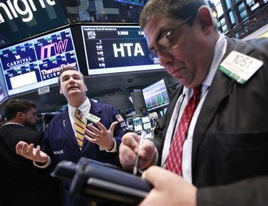 Floor governor Patrick King (L) announces the start of trading of Healthcare Trust of America, Inc. on the floor of the New York Stock Exchange June 6, 2012. REUTERS/Brendan McDermid