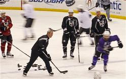 Los Angeles Kings head coach Darryl Sutter (L in Black) leads his team during a team practice before Game 5 of the NHL Stanley Cup Final between the New Jersey Devils and the Los Angeles Kings in Newark, New Jersey June 8, 2012. Game 5 of the Stanley Cup Final will be played June 9 in Newark. REUTERS/Adam Hunger