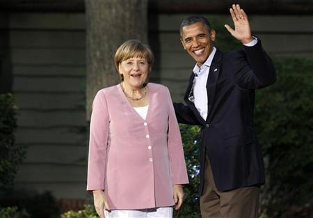 President Barack Obama greets Germany's Chancellor Angela Merkel as she arrives at the G8 Summit at Camp David, Maryland, May 18, 2012. REUTERS/Larry Downing