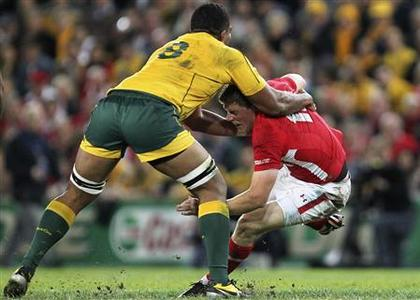 Australia's Wycliff Palu tackles Wales' Rhys Priestland (R) during their international rugby union test match in Brisbane June 9, 2012. REUTERS/Jason O'Brien