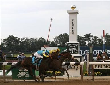 Union Rags, with jockey John Velazquez in the irons (R), crosses the finish line ahead of Paynter, with jockey Mike Smith in the irons, to win the 144th Belmont Stakes, the final leg of horseracing's Triple Crown, at Belmont Park in Elmont, New York, June 9, 2012. REUTERS/Keith Bedford