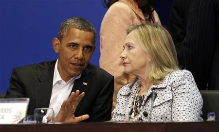 U.S. President Barack Obama and Secretary of State Hillary Clinton talk during the plenary session of the Summit of the Americas in Cartagena April 14, 2012. REUTERS/Kevin Lamarque