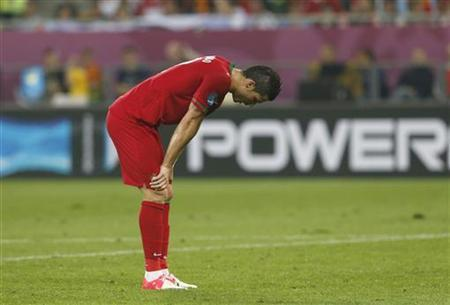 Portugal's Cristiano Ronaldo reacts after their Group B Euro 2012 soccer match against Germany at the New Lviv stadium in Lviv, June 9, 2012. REUTERS/Eddie Keogh