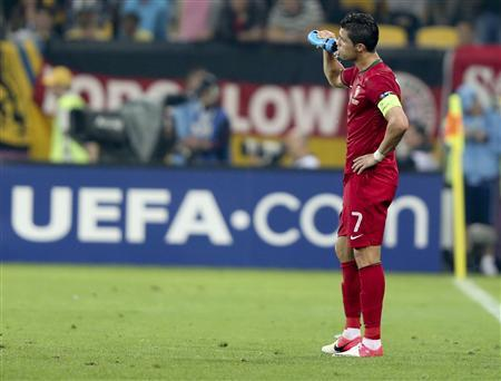 Portugal's Cristiano Ronaldo reacts after losing their Group B Euro 2012 soccer match against Germany at the new stadium in Lviv, June 9, 2012. REUTERS/Thomas Bohlen