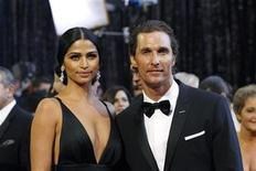 Actor Matthew McConaughey and his partner Camila Alves arrive at the 83rd Academy Awards in Hollywood, California, February 27, 2011. REUTERS/Mario Anzuoni