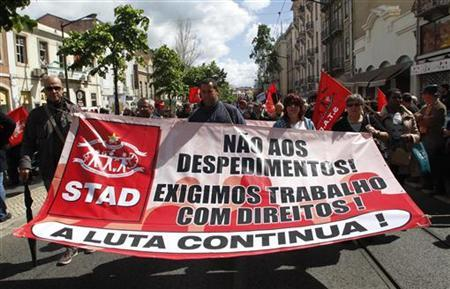 Workers shout slogans against austerity measures during a march by the Portuguese union CGTP in Lisbon May 1, 2012. REUTERS/Hugo Correia